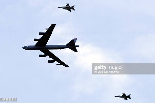 A US strategic bomber B52 is escorted by two Jordanian F16 fighter jets as they take part in joint JordanUS maneuvers during the 'Eager Lion'...