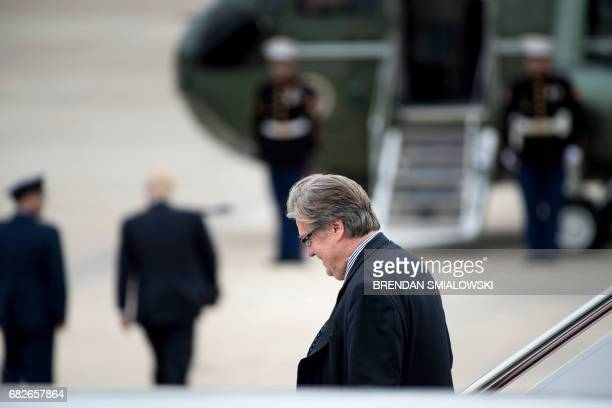 Strategist Steve Bannon walks off Air Force One as US President Donald Trump walks to Marine One at Andrews Air Force Base May 13 2017 in Maryland /...