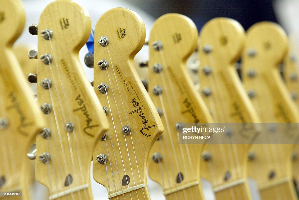 Stratocaster guitars at the Fender manufacturing facility in Corona, California, 28 June 2004. The sainted grandfather of electric guitars, the Fender Stratocaster, famously cradled on stage by music legends from Buddy Holly to Jimi Hendrix and Eric Clapton is celebrating it's 50 anniversary this year. AFP PHOTO / Robyn Beck AFP PHOTO / Robyn Beck