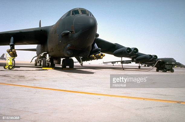 Stratofortress aircraft is serviced on the flight line prior to flying a bombing mission against Iraqi forces during Operation Desert Storm The...