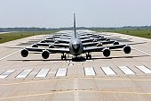 Six KC-135 Stratotankers demonstrate the elephant walk formation as they taxi down a runway right behind each other during a generation exercise August 5 at McConnell Air Force Base, Kansas. The exerc