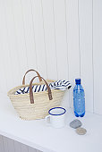 Straw bag and mineral water