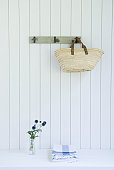 Straw bag hanging on wall