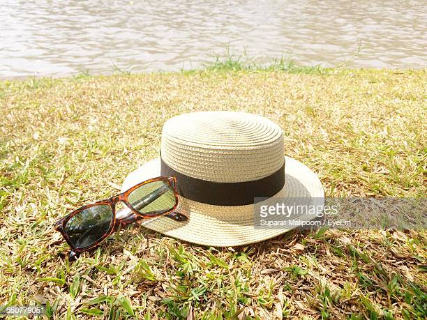 Straw Hat With Sunglasses On Riverbank