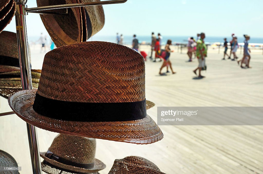 Straw hats are displayed for sale at a store on the Coney Island boardwalk as people enjoy an afternoon at the beach on one of the hottest weeks in recent New York City history on July 18, 2013 in New York City. With daily temperatures in the high 90's and with the heat index making it feel in the triple digits, many New Yorkers are doing what they can to stay cool. A break from the heatwave is not expected until Saturday evening at the earliest.
