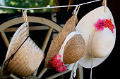 Straw hats hanging on a clothesline