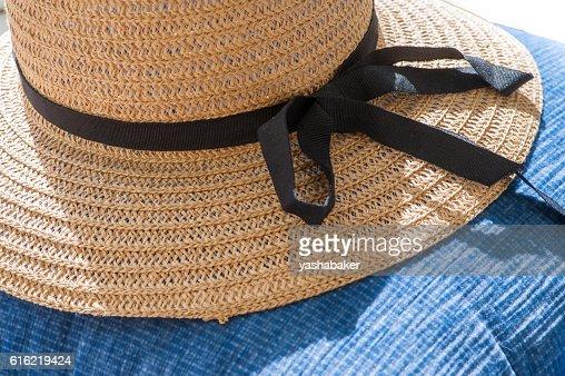 Straw summer hat on blue background : Stock Photo