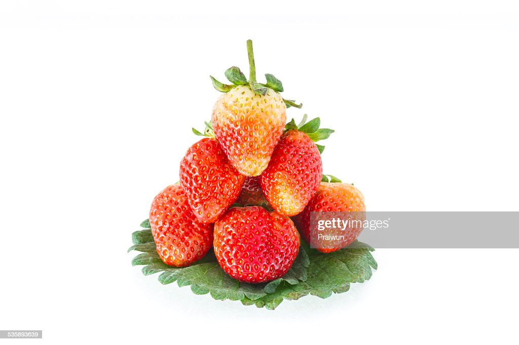 Strawberries and leafs on white background : Stock Photo