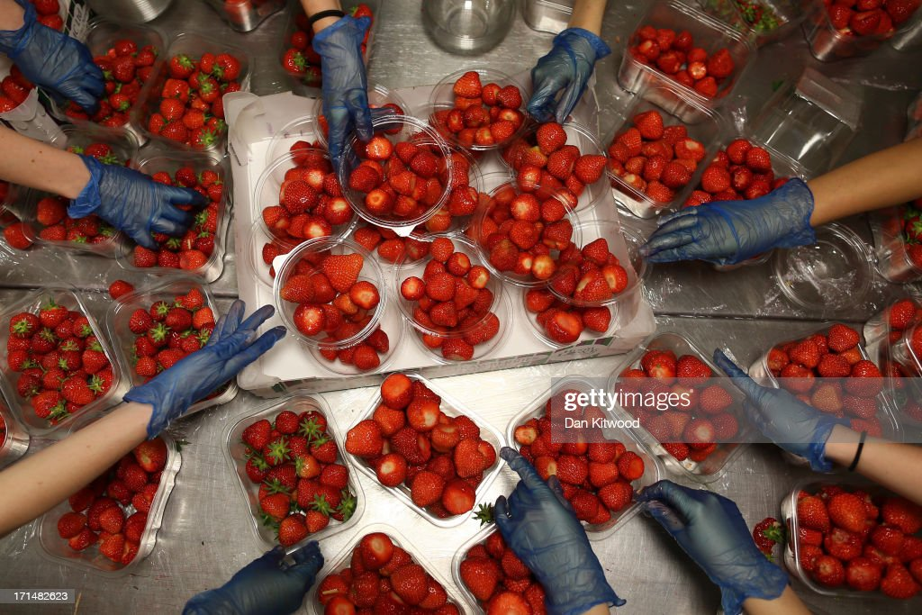 Strawberries are prepared during day two of the Wimbledon Lawn Tennis Championships at the All England Lawn Tennis and Croquet Club on June 25, 2013 in London, England.