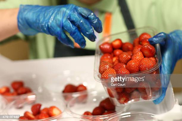 Strawberries are prepared on day four of the Wimbledon Lawn Tennis Championships at the All England Lawn Tennis and Croquet Club on July 2 2015 in...