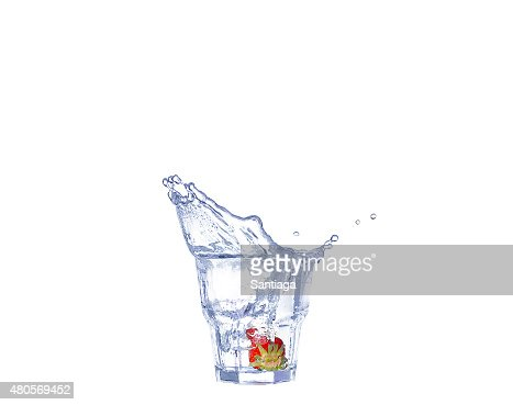 Strawberries, ice cubes into the glass : Stock Photo