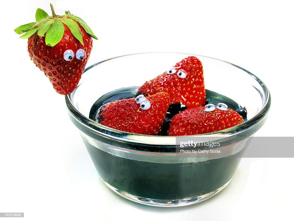 Strawberries in bowl of chocolate : Stock Photo