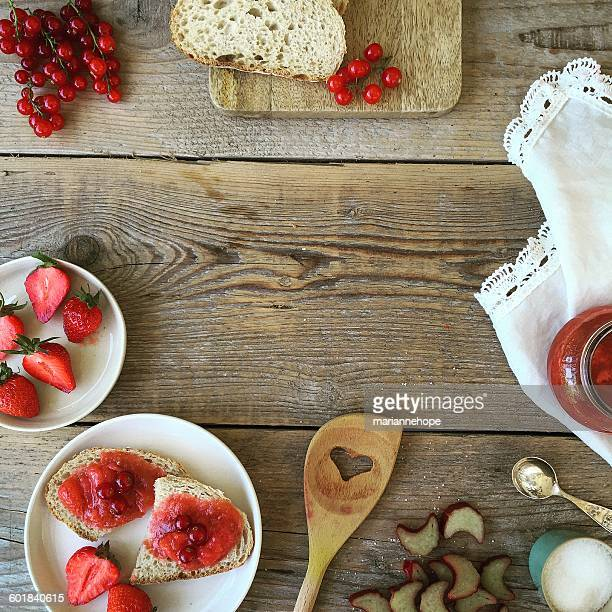 Strawberries, redcurrants, bread and jam