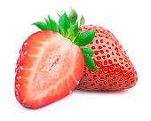 Perfectly retouched strawberries with sliced half and leaves isolated on white background with clipping path