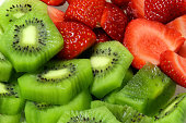 strawberry and kiwi fruit slices together full frame
