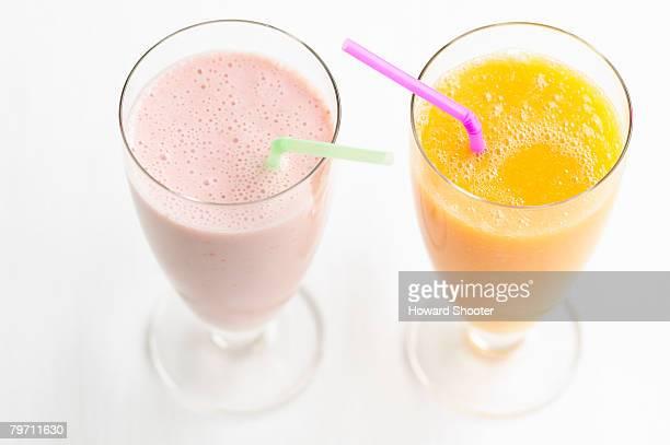 Strawberry and orange smoothie, studio shot