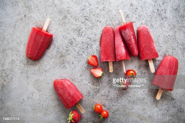 Strawberry and tomato ice lollies
