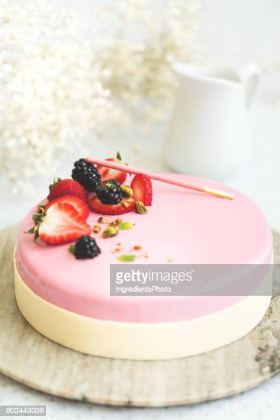 Strawberry cake on a bright background with flowers.