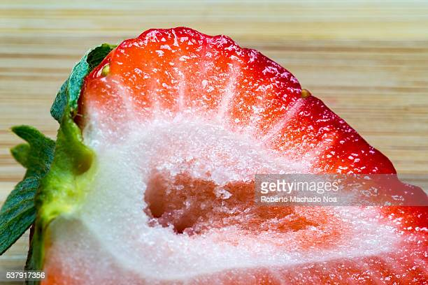Strawberry close up Fruit cut in half The garden strawberry is a widely grown hybrid species of the genus Fragaria It is cultivated worldwide for its...