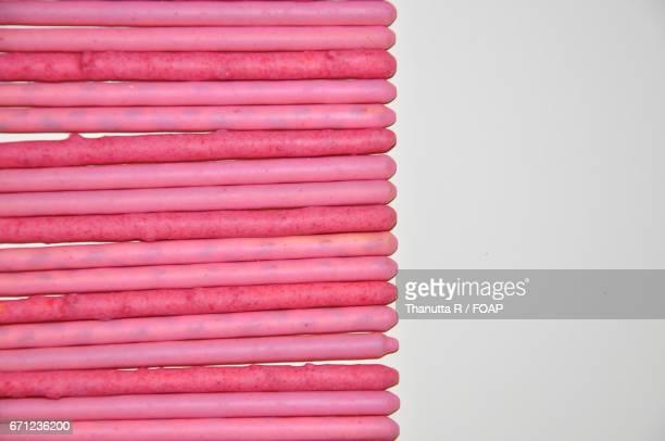 Strawberry cream covered biscuit sticks
