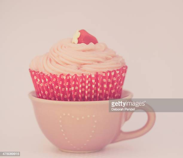 Strawberry cupcake in a pink teacup