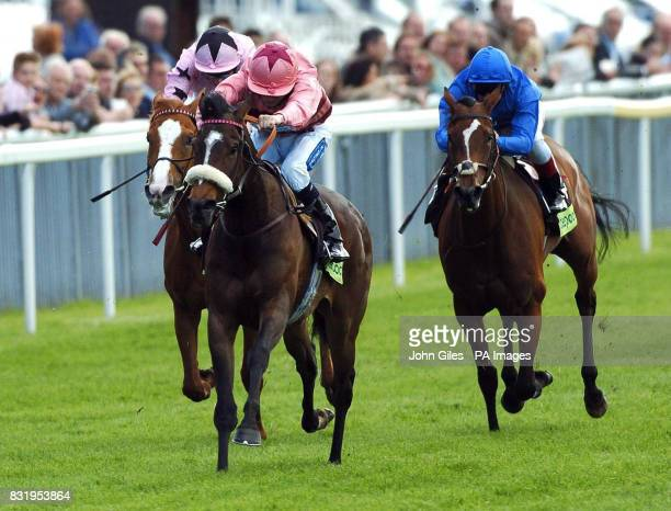 Strawberry Dale ridden by jockey Jamie Spencer on the way to winning against Portrayal ridden by jockey Frankie Dettori in the Totepool Middleton...
