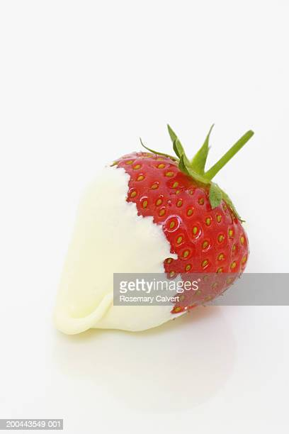 Strawberry dipped in whipped cream, close-up