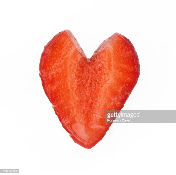 Strawberry heart on white background.