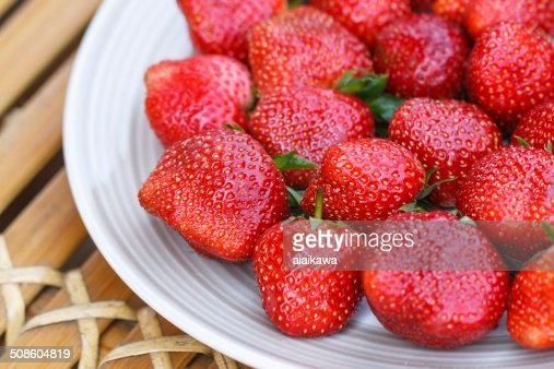 Strawberry in a disk on bamboo table : Stock Photo
