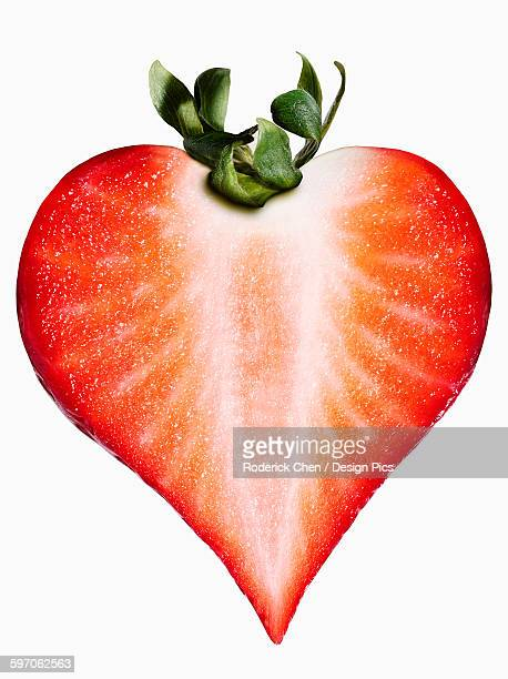 Strawberry in the shape of a heart on a white background