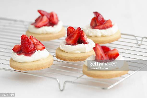 Strawberry shortcakes on a cooling rack, studio shot