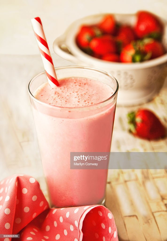 Strawberry smoothie and strawberries