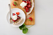 Strawberry summer tart with cream, food above