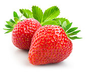Strawberry. Two berries with leaves isolated on white background.