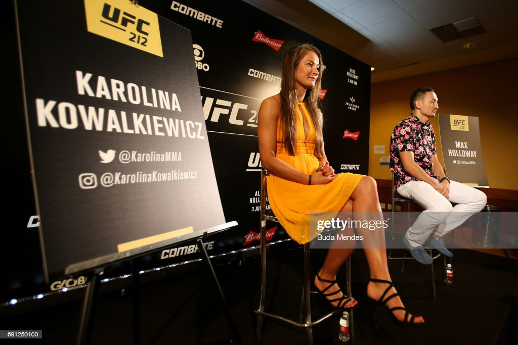 UFC strawweight contender Karolina Kowalkiewicz of Poland and UFC featherweight interim champion Max Holloway of the United States speak to the media during Ultimate Media Day at Windsor Hotel on June 01, 2017 in Rio de Janeiro, Brazil.