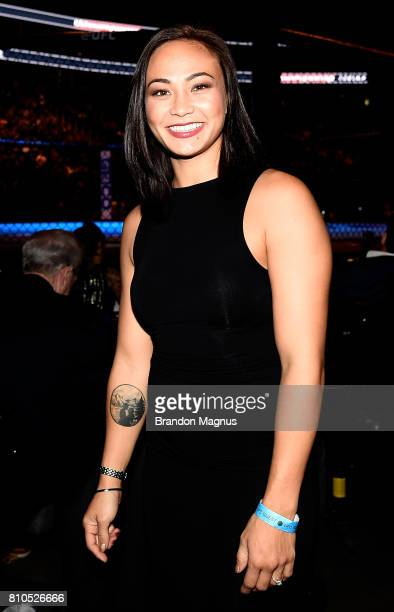 UFC strawweight Michelle Waterson poses for a photo Octagonside during The Ultimate Fighter Finale at TMobile Arena on July 7 2017 in Las Vegas Nevada