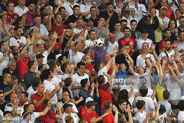 TOPSHOT A stray shot lands in the crowd during the Euro 2016 group B football match between Slovakia and England at the GeoffroyGuichard stadium in...