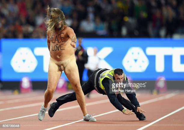 A streaker avoids a tackle from a security guard during day two of the 16th IAAF World Athletics Championships London 2017 at The London Stadium on...