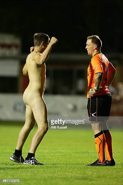 A streaker confronts Devon Spence of Bayswater City during the National Premier League Grand Final match between Bayswater City SC and Blacktown City...
