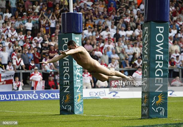 Streaker dives over the tryline during the Powergen Challange Cup Semi Final match between St Helens and Huddersfield Giants at The Halliwell Jones...