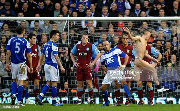 A streaker interupts play during the Barclays Premier League match between Birmingham City and Aston Villa at St Andrews on January 16 2011 in...