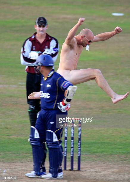 A streaker invades pitch and leaps the stumps during the NatWest Pro40 Division One match between Somerset and Durham at the County Cricket Ground on...