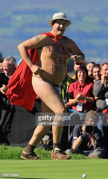 A streaker invades the 18th green in the singles matches during the 2010 Ryder Cup at the Celtic Manor Resort on October 4 2010 in Newport Wales
