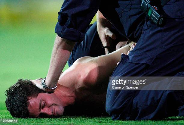 A streaker is arrested by police after entering the field of play during the Commonwealth Bank Series One Day International match between Australia...