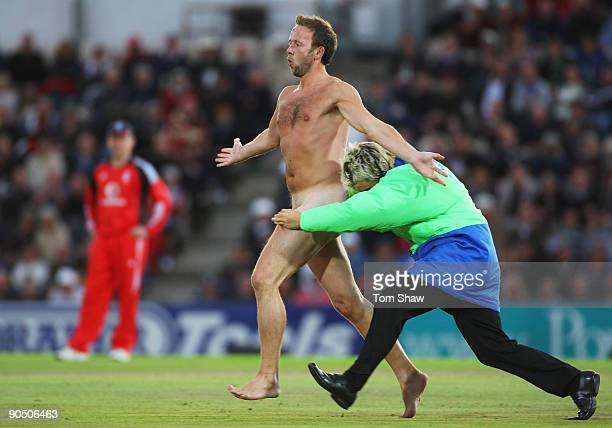 A streaker is tackled by a member of security during the 3rd NatWest One Day International between England and Australia at the Rose Bowl on...
