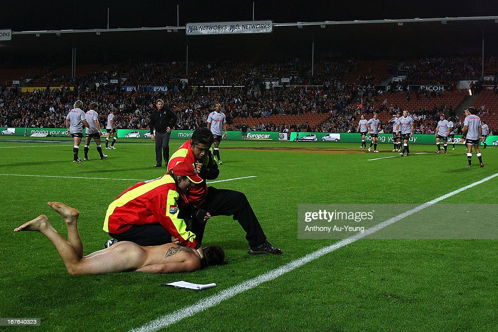 A streaker is taken down by security guards prior to kick off during the round 11 Super Rugby match between the Chiefs and the Sharks at Waikato Stadium on April 27, 2013 in Hamilton, New Zealand.