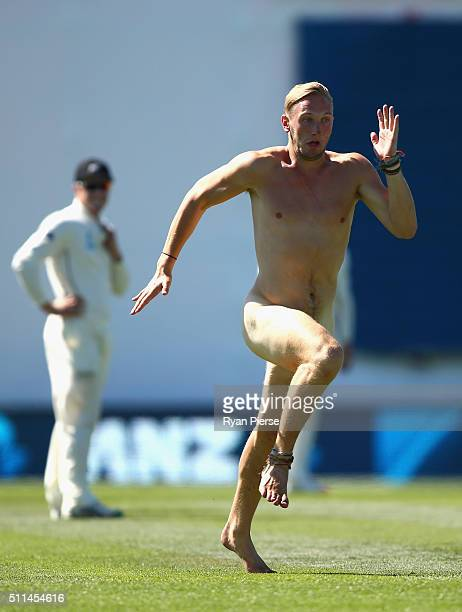A streaker runs on the pitch during day two of the Test match between New Zealand and Australia at Hagley Oval on February 21 2016 in Christchurch...