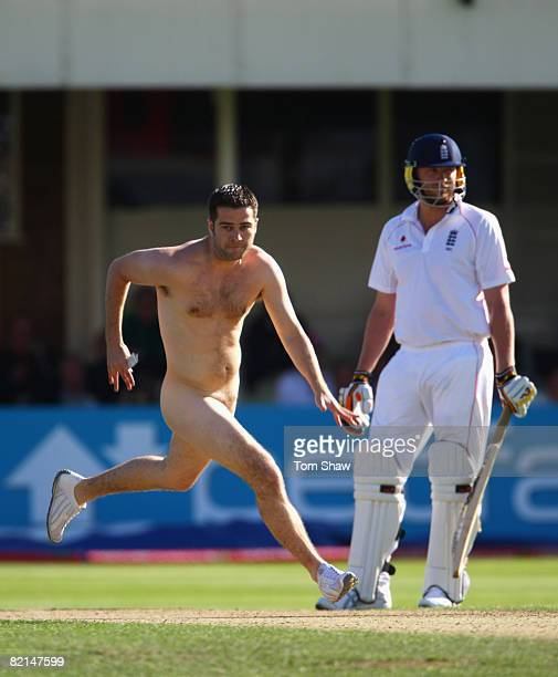 A streaker runs on the wicket as Andrew Flintoff of England looks on during day 3 of the 3rd Test Npower Test Match between England and South Africa...