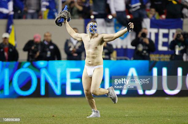 A streaker runs onto the field during an international friendly match between Mexico and BosniaHerzegovina at Georgia Dome on February 9 2011 in...