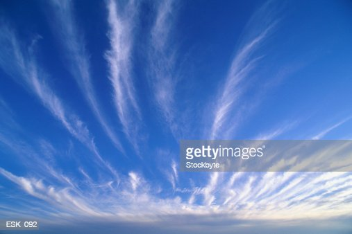 Streaks of cirrus clouds in bright sky : Stock Photo